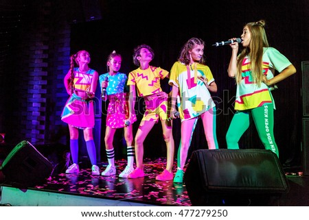 "ODESSA, UKRAINE -30 August 2016: The most fashionable this season Band ""Open Kids"" performs on stage with vocal number. Teenage girls singing on stage"
