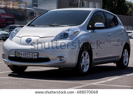 Odessa, Ukraine - August 1, 2017: The Nissan Leaf of Grey Colour electric vehicle parked on the street asphalt parking at shopping center.