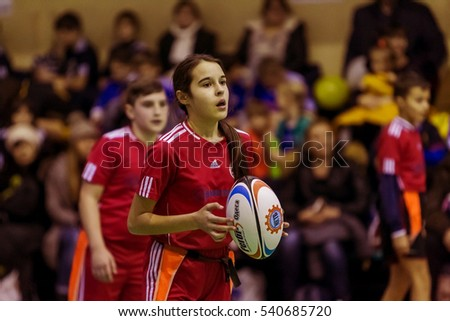 Odessa, Ukraine - December 17, 2016: Children playing rugby derby tournament in Odessa. Struggle for the victory of children in game of rugby on floor in closed room. Children in Sport