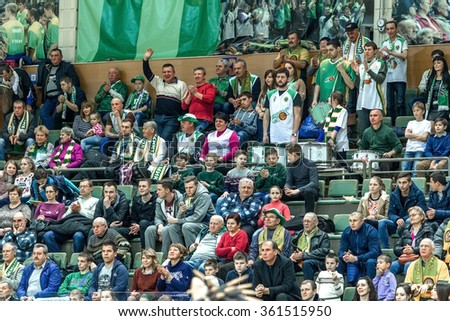 Odessa, Ukraine - December 25, 2015: Fans of the basketball team and the spectators in the stands emotionally support their team during an intense derby. Stadium. Basketball Club - stock photo