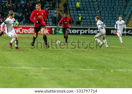 Odessa, Ukraine - December 8, 2016: Football game of  Europa League. FC Zorya Lugansk and FC Manchester United. 0: 2. Tense active fight for ball. Manchester United player 9 Zlatan Ibrahimovic