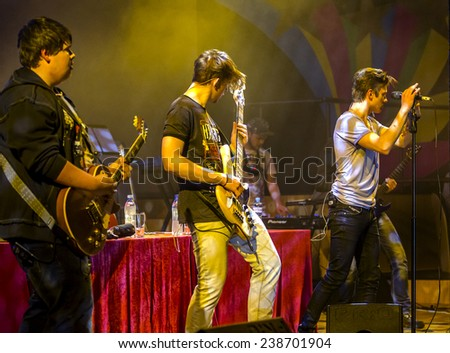 "Odessa, Ukraine - December 13, 2014: Ukrainian electronic pop group performs at a concert - hall ""ODESSA"" during a fight in mixed martial arts MMA, December 13, 2014, Odessa, Ukraine - stock photo"