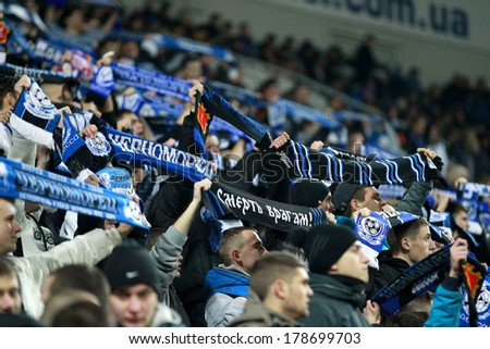 ODESSA, UKRAINE - FEBRUARY 20: Fans and supporters of FC Chernomorets Odessa during the match against Olympique Lionnais , support their team, February 20, 2014 in Odessa