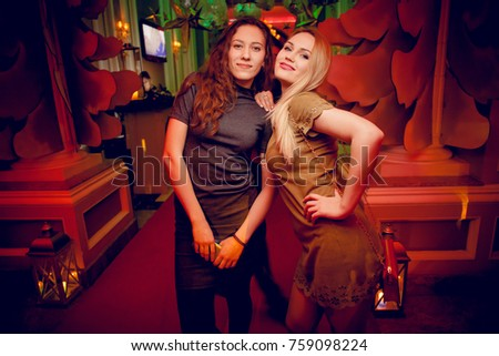 Odessa, Ukraine January 7, 2017: Ministerium night club. Women smiling and posing on cam during concert in night club party. Girl have fun at club. girl at night club party
