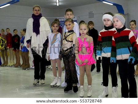 Odessa, Ukraine - January 27, 2016: Young children in the sports arena, ice skating. Kids are skating on  the ice sports field. Children are engaged in winter sports on ice