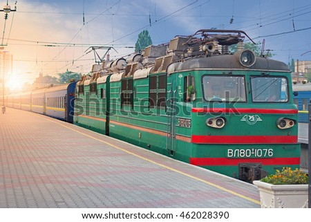 ODESSA, UKRAINE - JULY 29, 2016: An old style passenger train an the railway station of Odessa in the rays of morning sun, Ukraine