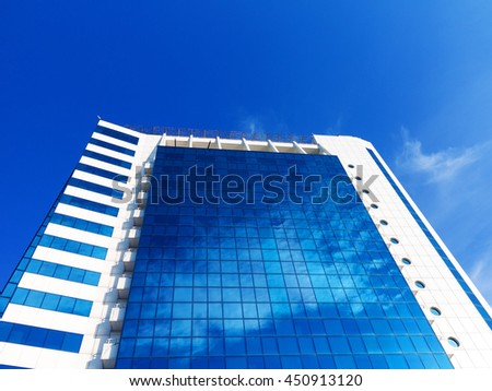 Odessa, Ukraine July 6, 2016: Bottom view of modern high rise building in the port in the sunset at the end of the day in Odessa, Ukraine, July 6, 2016 - stock photo