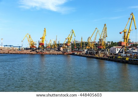 Odessa, Ukraine - July 6, 2016: Container cranes in cargo port terminal, cargo cranes without job in an empty harbor port. A crisis. Defaulted paralyzed entire economy of  state, in the EU candidate
