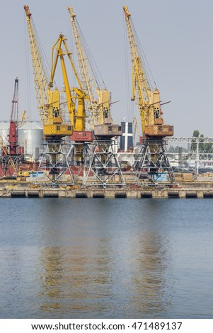 Odessa, Ukraine - July 30, 2016: Container cranes in cargo port terminal, cargo cranes without job in an empty harbor port. A crisis. Defaulted paralyzed entire economy of state
