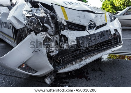 ODESSA, UKRAINE - July 11, 2016: Crash accident on the street with a police crew. Police car during the chase the offender lost control and created a major accident. Broken car in the collision