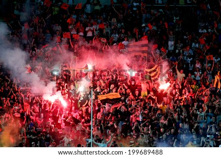 ODESSA, UKRAINE - July 10, 2013: emotional football ultras fans during the game Shakhtar Donetsk and Chernomorets rioted on the playing field, July 10, 2013, Odessa, Ukraine - stock photo