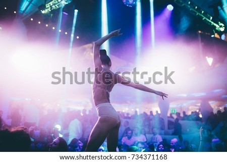 Odessa, Ukraine July 30, 2015: Ibiza Night club dj party people enjoy of music dancing sound with colorful light, smoke machine, lights show and dance show. Hands up in the earth.