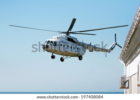 ODESSA, UKRAINE - JULY 04: military government MI-8 helicopter makes a landing on the island of Serpents (ZMEINUI) working in normal mode July 4, 2008 in Odessa, Ukraine.