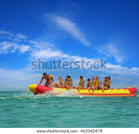 "ODESSA, UKRAINE - JULY 30, 2016: People having fun on ""banana"" boat, Ukraine"