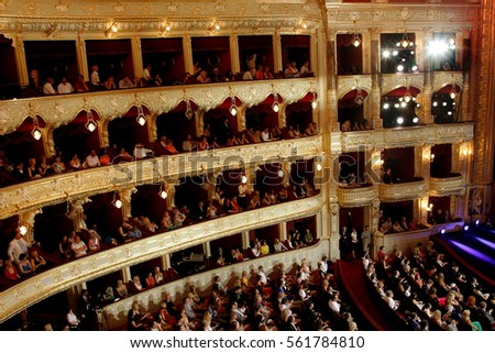 ODESSA, UKRAINE - July 21, 2012: Spectators in audience hall of viewers of Odessa State Opera and Ballet Theatre during opening of International Film Festival. Audience at concert at theater