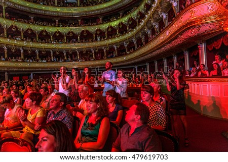 ODESSA, UKRAINE - July 16, 2016: Ukrainian singer Jamala at solo concert at Opera House. Satisfied with fans in hall. Spectators at concert during creative light, music show fashionable jazz orchestra