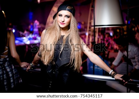Odessa, Ukraine june 8, 2014: Bono beach club. Women smiling and posing on cam during concert in night club party. Girl have fun at club. girl at night club party