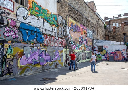 "Odessa, Ukraine -18 June 2015: gang graffiti painted walls . Residents of homes are struggling with illegal graffiti. Repaired walls, paint over pictures. Inscription wall, ""Thank you for clean wall"""