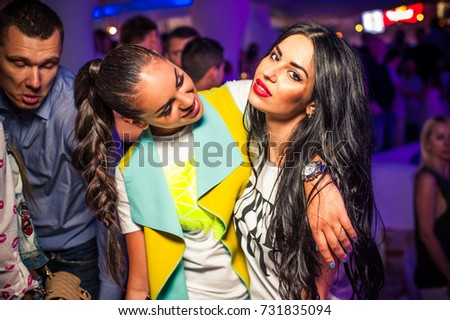 Odessa, Ukraine June 26, 2015: Ibiza club. Women smiling and posing on cam during concert in night club party. Girl have fun at club. girl at night club party