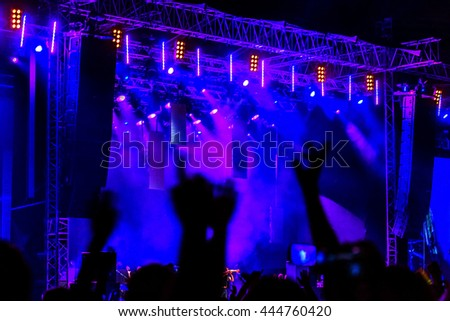 Odessa, Ukraine - June 25, 2016: large crowd of spectators having fun at stadium, at  concert of Ukrainian group Ocean Elzy during the creative light and music show. Cheerful bright show in party club