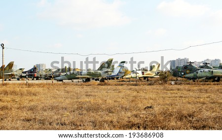 ODESSA, UKRAINE - JUNE 26 , 2011: Old broken military aircraft , jet fighters , bombers and helicopters are on  airplane graveyard obsolete , unserviceable equipment June 26, 2011 in Odessa , Ukraine.