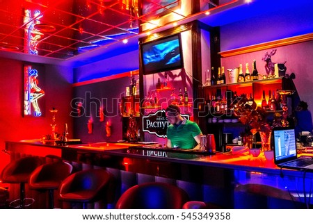 ODESSA, UKRAINE - June 6, 2015: The bar with expensive drinks  in night strip club. Men's clubs showing striptease gaining popularity during the crisis in the country. Striptease bar