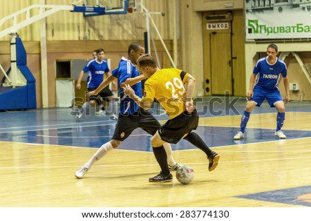 Odessa, Ukraine - June 2, 2015: Unidentified players local teams playing in  tournament of mini-football in futsal on parquet floor. Poor lighting in an inexpensive futsal. Men spend leisure, Hobbies - stock photo