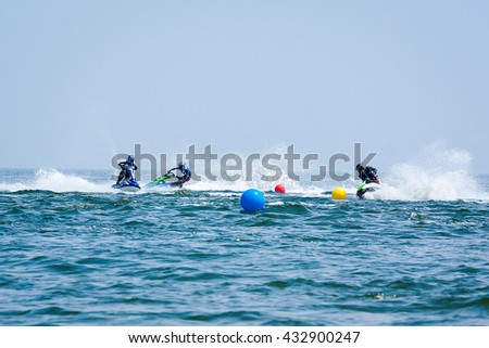 Odessa, Ukraine - June, 2012: Young Man on Jet Ski. Professional jet ski rider. Jet Ski Championship. Jetski performs many tricks on the waves.