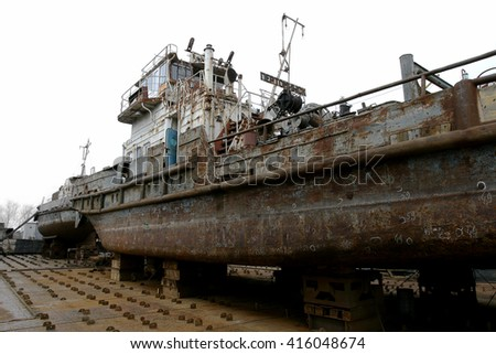 ODESSA, UKRAINE - MARCH 12, 2008: Photo Archive. Drydock Ust-Danube port, it is now destroyed. Marine boat is at the bottom of the repairs in dry dock float