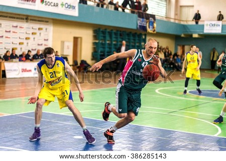 ODESSA, UKRAINE - March 5, 2016: Ukrainian Cup Basketball. Fight the leaders of the tournament the team Super League of Odessa and Zaporozhye. Rigid emotional for the ball near the basket ring.