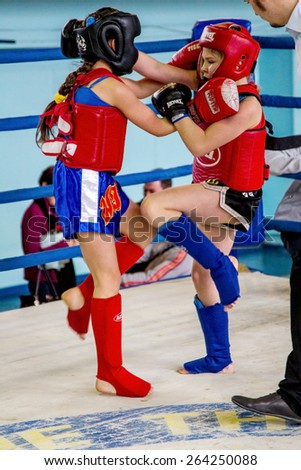 Odessa, Ukraine March 27, 2015: Ukrainian Cup on boxing among children. Muay Thai boxing. In the ring fighting girls boxers. Women's boxing.