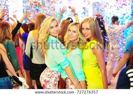 Odessa, Ukraine May 23, 2014: Ibiza club. People smiling and posing on cam during concert in night club party. Man and woman have fun at club. Boy and girl at night club party