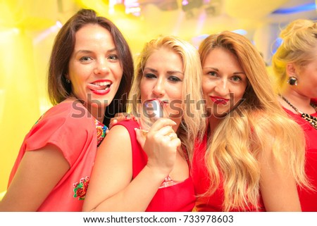 Odessa, Ukraine May 31, 2014: Ibiza club. Women smiling and posing on cam during concert in night club party. Girl have fun at club. girl at night club party