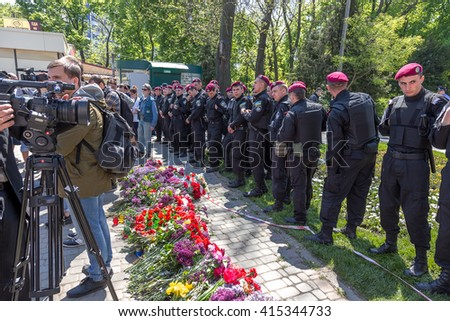 ODESSA, UKRAINE - May 2, 2016: Police   put police cordon  mining of territory and do not let people lay flowers to victims of Khatyn Tragedy Odessa, House of Trade Unions,  people were burnt alive
