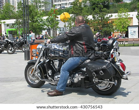 "Odessa, Ukraine, May 29, 2016 -: Typical biker on his motorcycle close-up on ""Bike show"", parked in the open air in the city center. Shallow depth of field."