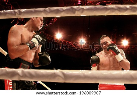 ODESSA, UKRAINE -31 May 2014: World heavyweight boxing champion, Alexander USYK - Ukraine and Cesar David CRENZ  Argentina in the boxing ring. Professional boxing K2, May 31, 2014 in Odessa, Ukraine.
