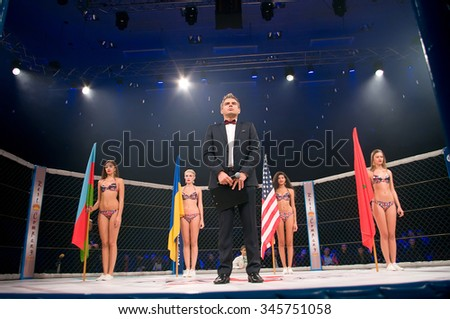 Odessa, Ukraine - NOVEMBER 24: Beautiful Ring-Girls entering the arena on competition between fights MMA Mixed Martial Arts. November 24, 2015 in Odessa, Ukraine - stock photo
