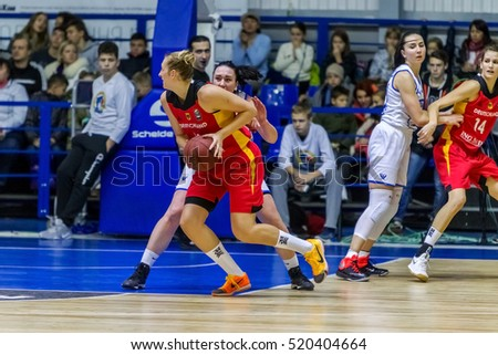 ODESSA, UKRAINE - 19 November 2016: European Basketball Championship for women. The national team of Ukraine adopts German national team. Wrestling athletes for ball on basketball court