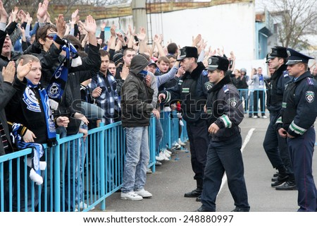 Odessa, Ukraine - November 14, 2010: Ultras emotional football fans during the game for his club Chernomorets rioted with police, broken rostrum, fights, fireworks on the playing field