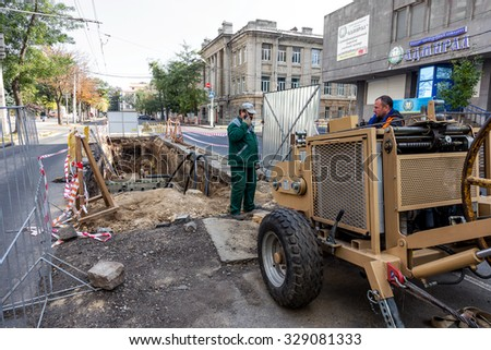 Odessa, Ukraine -October 18,2015: building technologies. Installation  pipe by drilling point under highway. Pulling cable and pipe drilled underground Stroebe. Modern complex laying of plastic pipes