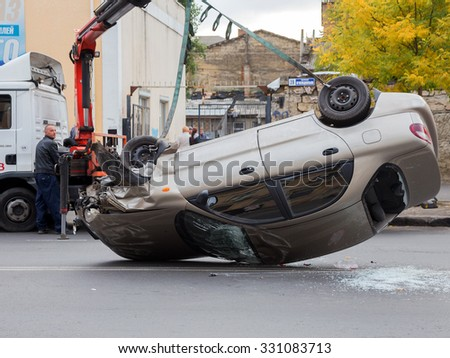 ODESSA, UKRAINE - OCTOBER 24, 2015: car hauler picks up after a car accident October 24, 2015 in Odessa, Ukraine