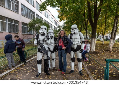 Odessa, Ukraine -25 October 2015: Darth Vader's stormtroopers just communicate with humans, photographed with children. Fictional characters Star Wars appeared in real life in  elections to  councils
