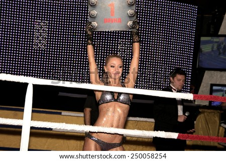 Odessa, Ukraine - October 14, 2010: Fight Club. Fighting without rules. Mixed martial arts fighters compete in the cell, resulting in punches and kicks. Girl Cheerleaders in action. - stock photo