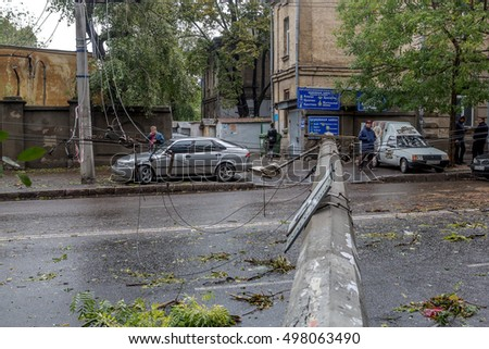 Odessa, Ukraine - October 12, 2016: Hurricane CHRISTIE. Heavy rain and gale - force gusts of wind caused accident - old tree during storm fell on car, destroyed house. Strong storm and storm with rain