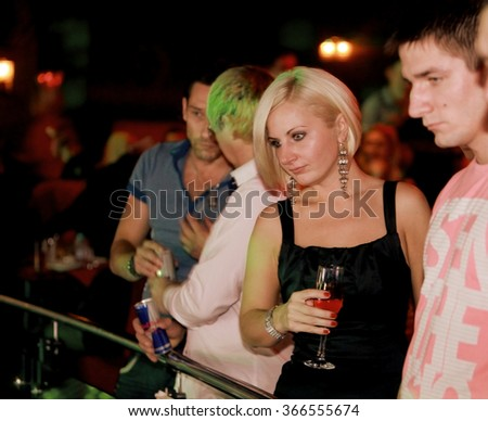 Odessa, Ukraine - October 22, 1020: Jubilee men's magazine Playboy nightclub. Beautiful girls entertain guests, beauty pageant, dancing, erotic and light show. The audience at the concert