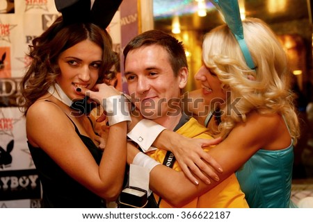 Odessa, Ukraine - October 22, 1020: Jubilee men's magazine Playboy nightclub. Beautiful girls entertain guests, beauty pageant, dancing, erotic and light show. The audience actively rest at party