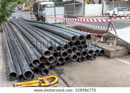 Odessa, Ukraine -October 18,2015: Modern building technologies. Installation plastic pipe by drilling point under highway. Pulling cable, pipe drilled  Stroebe. Modern complex laying of plastic pipes