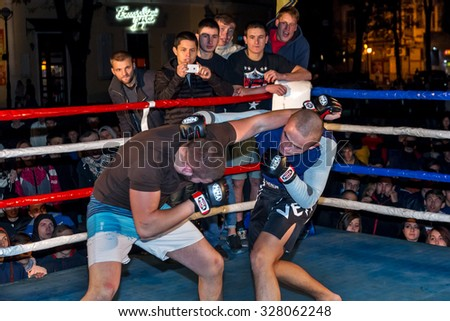 Odessa, Ukraine - October 14, 2015: Regional fights in the ring. Athletics MMA mixed martial arts fighters to compete, resulting in the throws and punches and kicks. The dramatic moment of the battle - stock photo