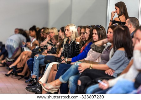 Odessa, Ukraine, October 3, 2015: The audience during a women's fashion show at Fashion Week in Odessa OFD. New Collection - 2015 Festival of fashion. Vybrochny focus. Emotional fans of the show