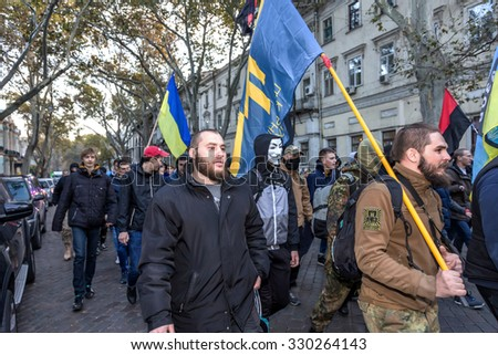 Odessa, Ukraine - October 14, 2015: Torchlight procession of radical extremists of left parties is accompanied by riots. Protesters, demonstrators carried a Nazi flag, burn fireworks and smoke bombs